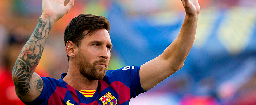 The Argentine captain and FC Barcelona striker Leo Messi greets the fans at the Camp Nou in Barcelona.