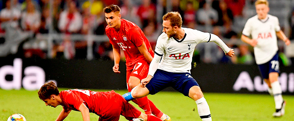Bayern Munich's Jonas Kehl (L) in action against Tottenham's Christian Eriksen (R) during the Audi Cup final in Munich