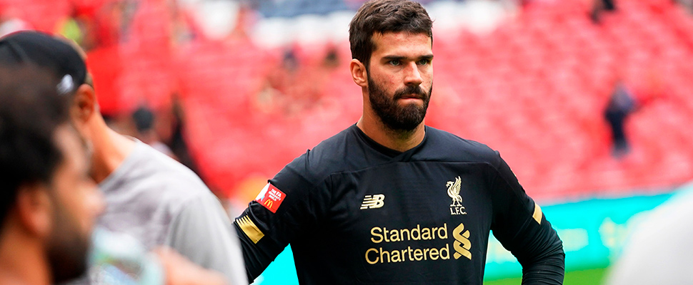 Liverpool's goalkeeper Alisson Becker reacts after the FA Community Shield soccer match at Wembley Stadium in London