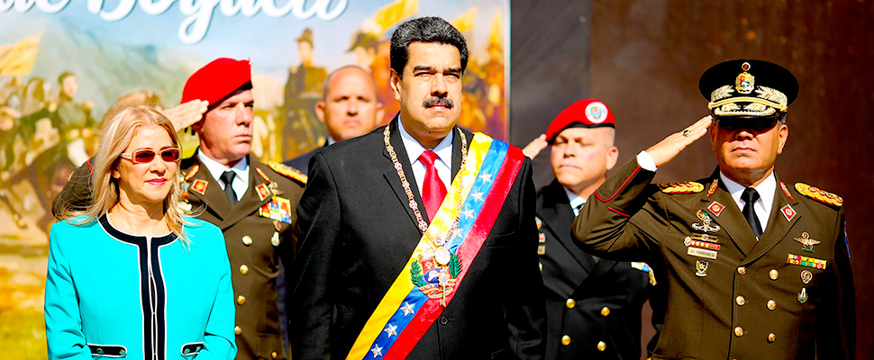 Venezuelan President Nicolas Maduro (C), and his wife, Cilia Flores (L), during an act of government in Caracas, Venezuela