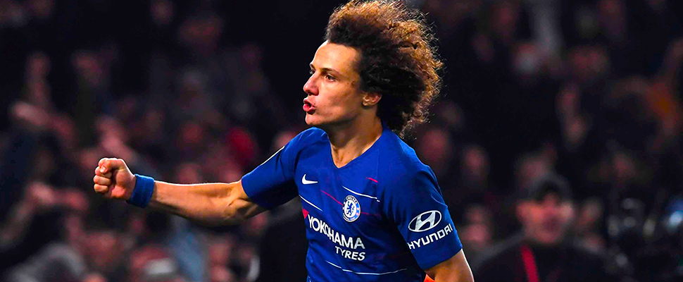 Chelsea David Luiz celebrates scoring the winning penalty during the Carabao League Cup semi final