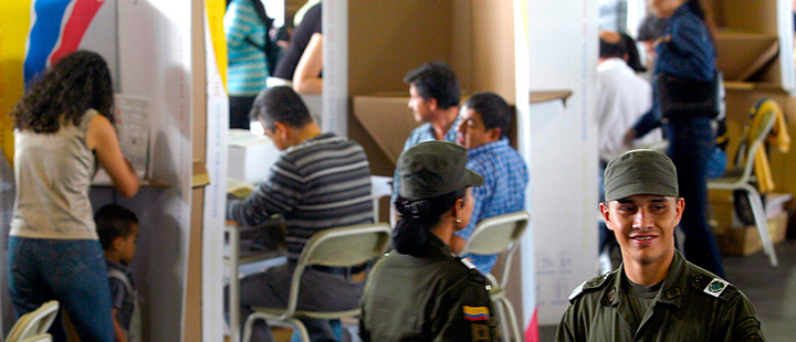 Colombian police supervising the polls while conducting an election day.