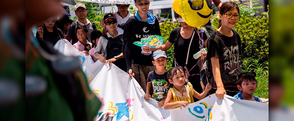 Demonstrators hold a banner during a march themed 'Guard Our Children's Future' in Hong Kong, China