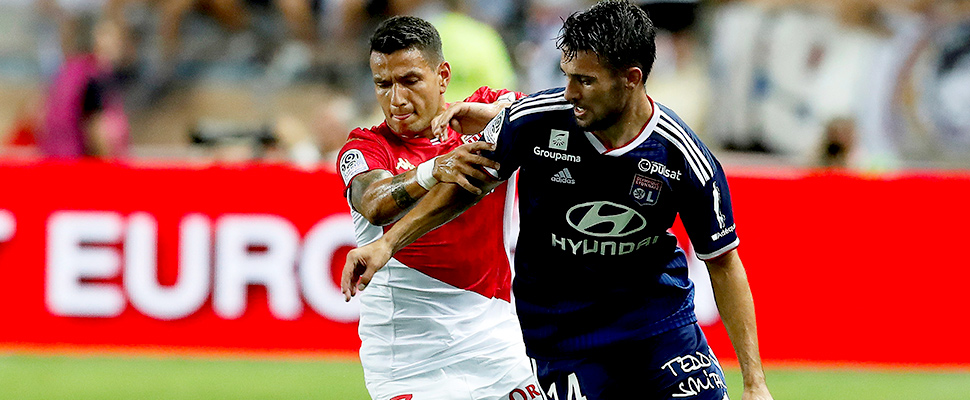 Rony Lopes (L) of AS Monaco and Leo Dubois (R) of Olympique Lyon in action during the French Ligue 1 soccer match