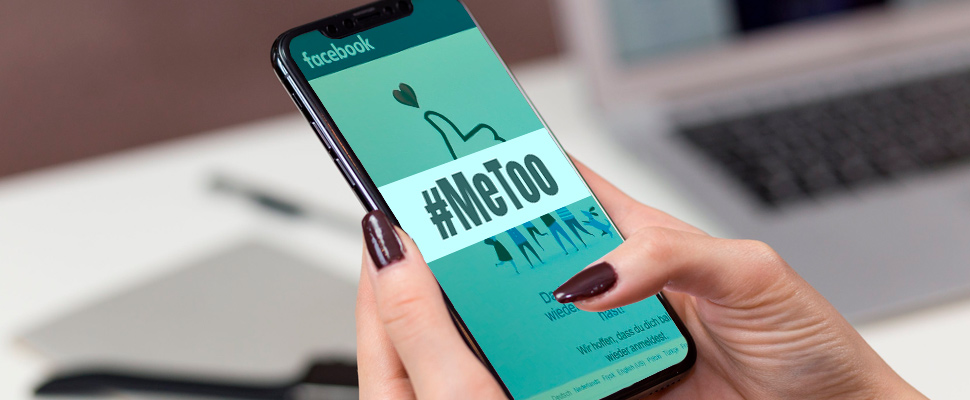 Woman holding a smartphone and watching Facebook with a sign of #MeToo