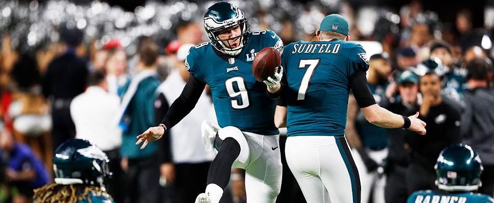 Philadelphia Eagles quarterback Nick Foles (L) celebrates with Nate Sudfeld after a touchdown during the Super Bowl LII.