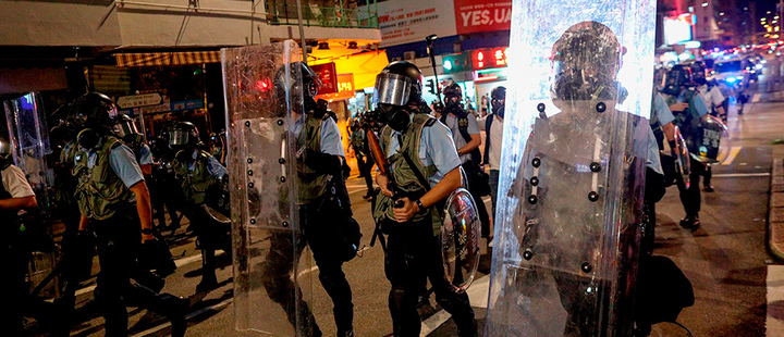 Policemen on duty as protesters attend an anti-government rally in Sham Shui Po, Hong Kong, China