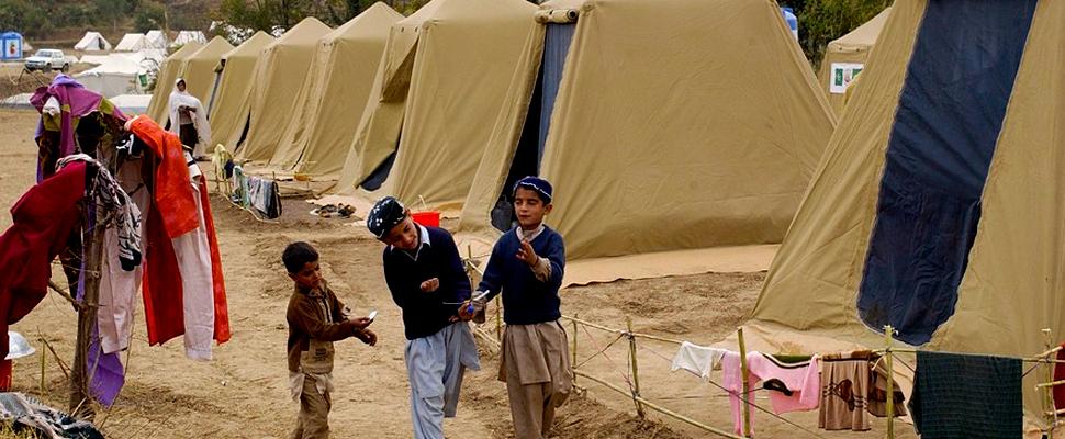 Children walking in a refugee camp