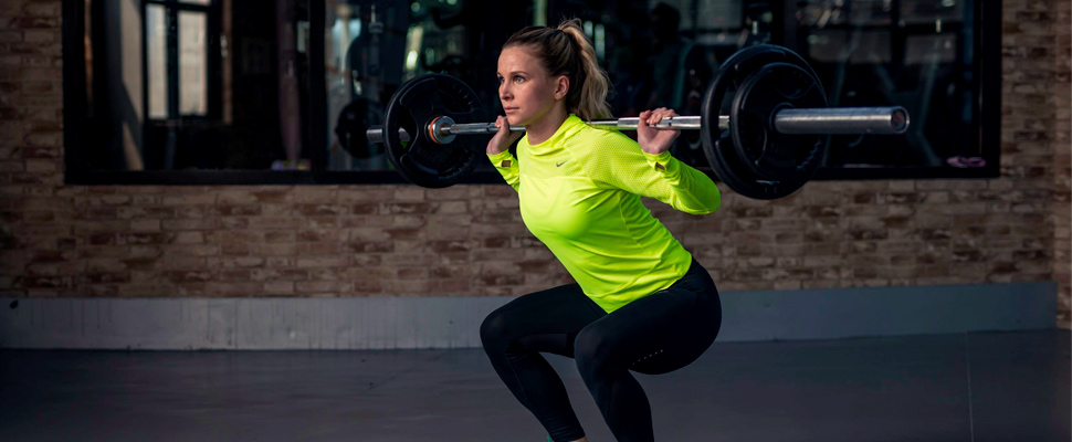 Woman lifting weights in the gym.