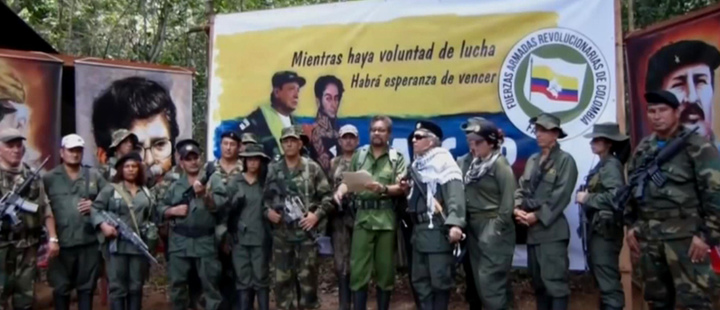 FARC commander Ivan Márquez, along with Jesús Santrich, reading the announcement that they will resume their insurgency