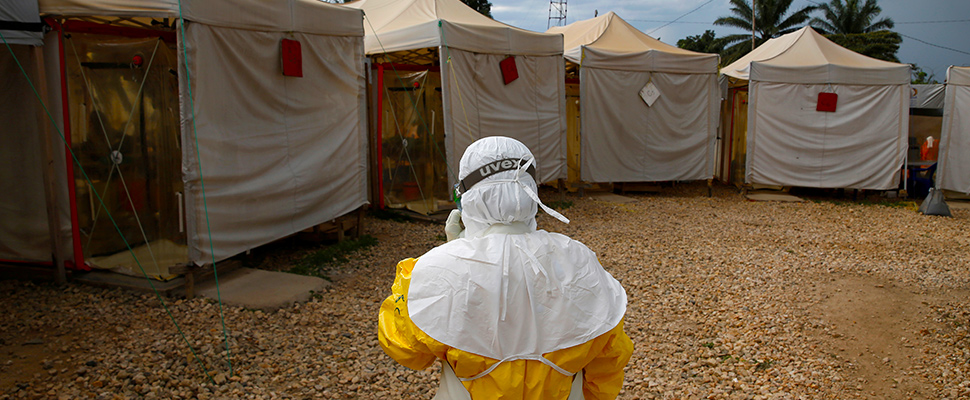 A health worker wearing Ebola protection gear, walks before entering the Biosecure Emergency Care Unit in the Congo