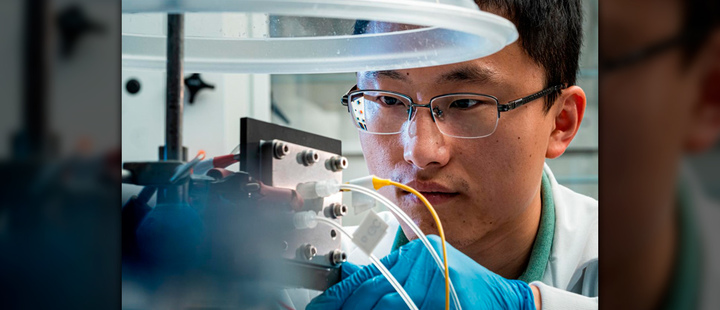 Rice University engineer Haotian Wang adjusts the electrocatalysis reactor built in his lab to recycle carbon dioxide