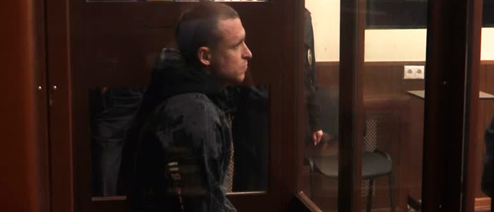 Russian soccer player Pavel MAmayev in defendant's glass cage.