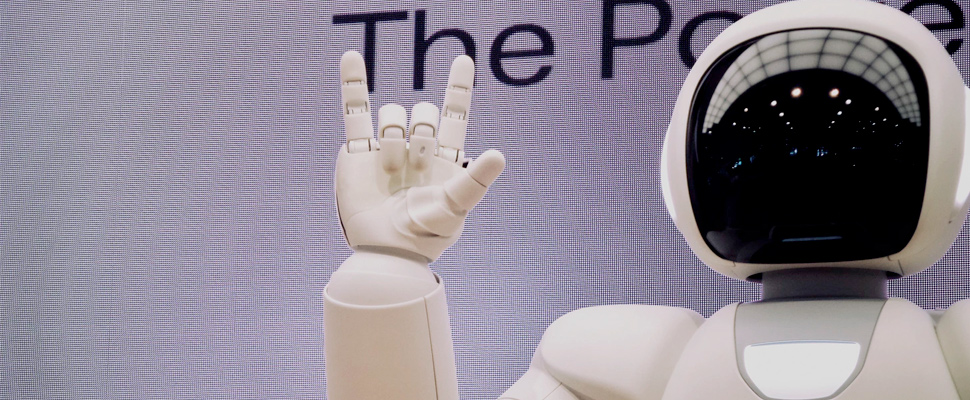 Robot making metal sign with his hand.