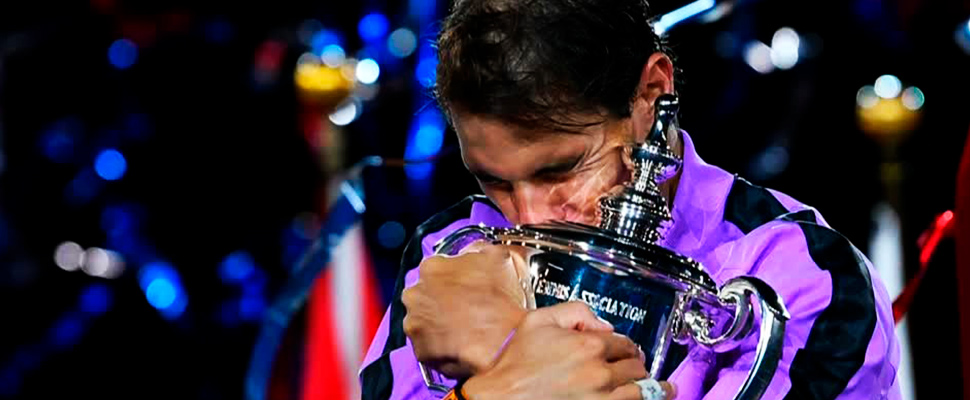 Rafael Nadal celebrates with the championship trophy during the ceremony after his match of the 2019 US Open