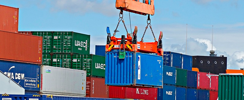 Container being lifted by a crane in a port