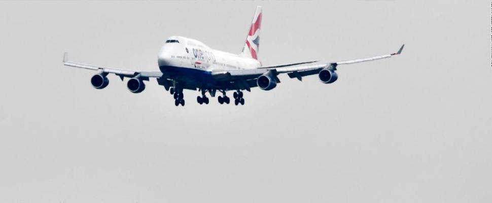 Boeing plane flying.