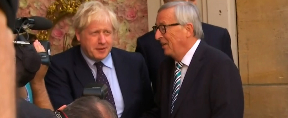 British Prime Minister Boris Johnson talks with European Commission chief Jean-Claude Juncker.