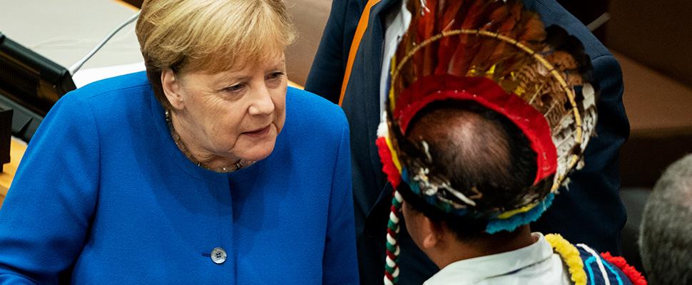 Angela Merkel habla con los participantes en la Conferencia de las Naciones Unidas sobre el Cambio Climático.