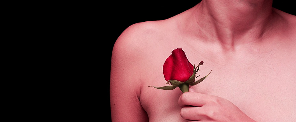 Woman with a rose near the chest.
