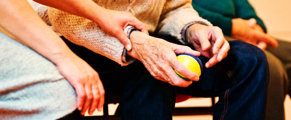 Elderly man holding a stress ball