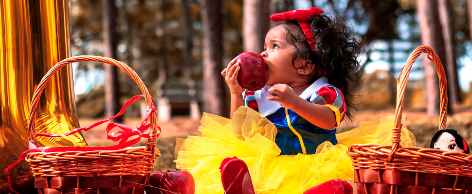 Girl wearing a Snow White costume.