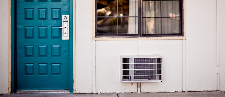 Air conditioning device outside a house.