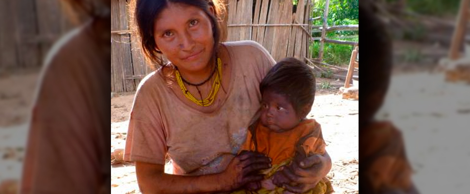 A Tsimane 'mother, with her child after painting him with plant dye in a practice believed to help protect from sickness