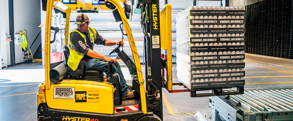Man using a hydraulic forklift.