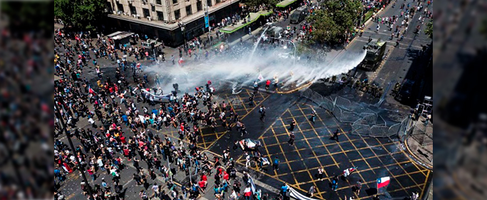 Police force dissipating protests in Santiago de Chile.