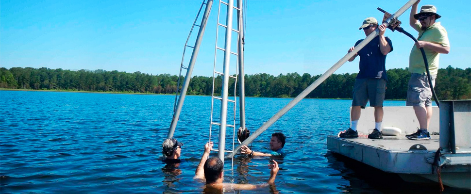 University of South Carolina archaelogists collect core samples from White Pond near Elgin, South Carolina.