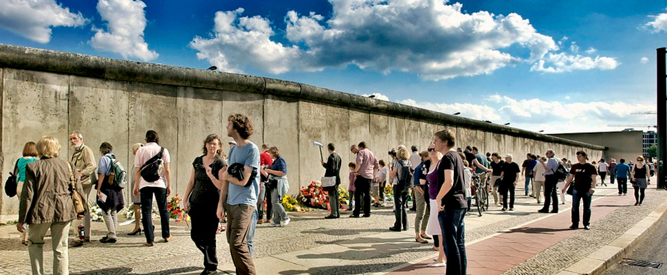 Tourists visiting the Berlin wall.