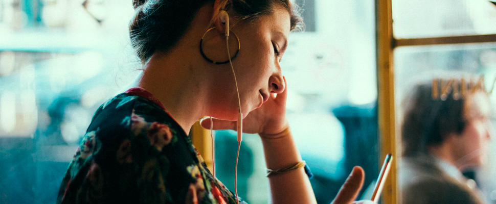 Woman using earphones.