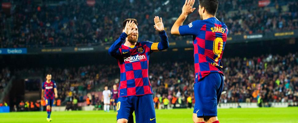 Lionel Messi y Luis Suárez durante un juego del FC Barcelona.