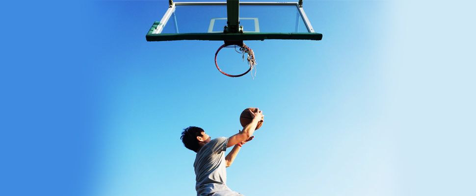 Man dunking the ball.
