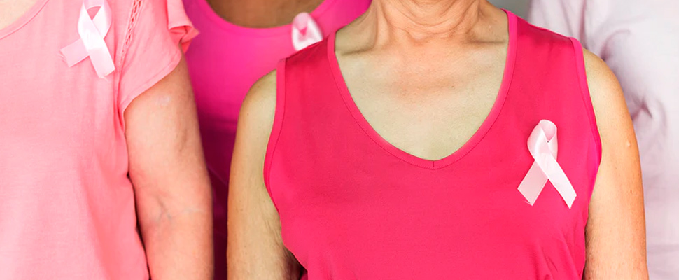 Women with a pink ribbon on their chest.
