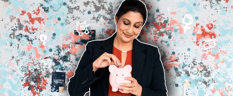 Woman saving money in a piggy bank.