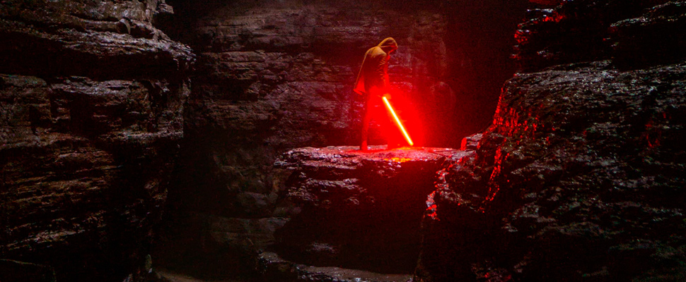 Person holding red lightsaber.
