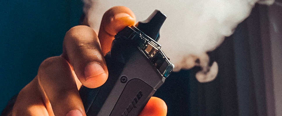 Person holding black vape.