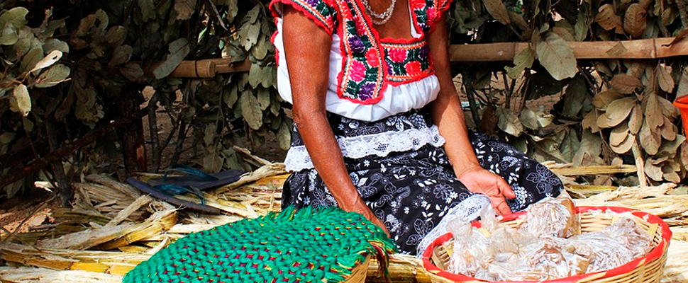 Mexican indigenous woman in a market stall.