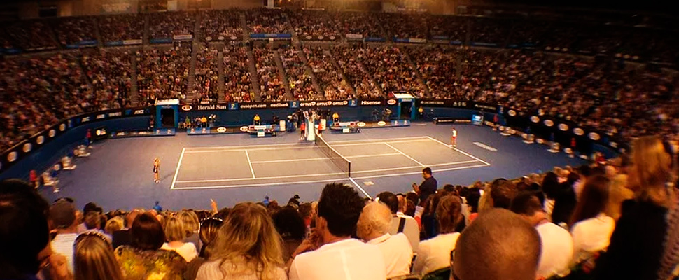 Audience watching a game of tennis during a version of the Australian Open.