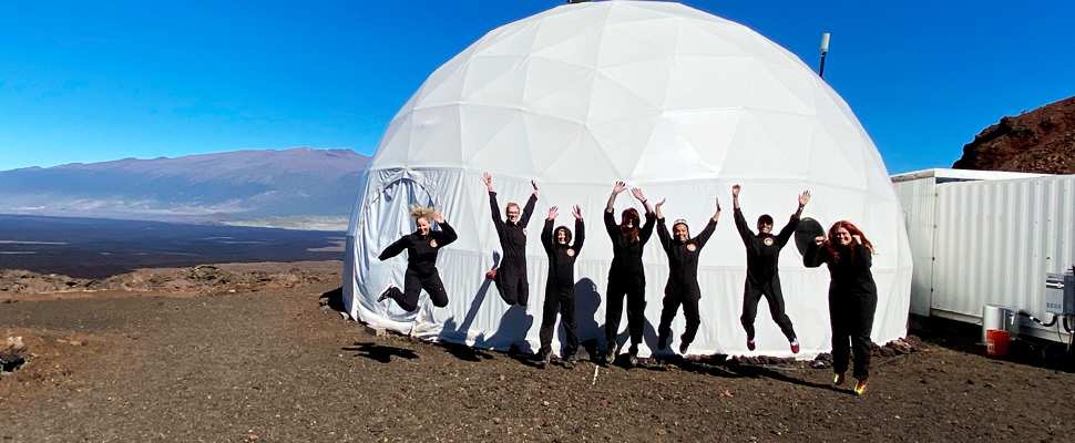The Sensoria crew jumps for joy before entering the mock Martian habitat on Jan. 4, 2020.