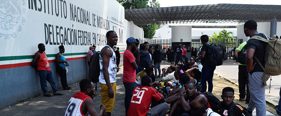 Migrants outside the facilities of the National Migration Institute (INM) in Tapachula, Mexico.