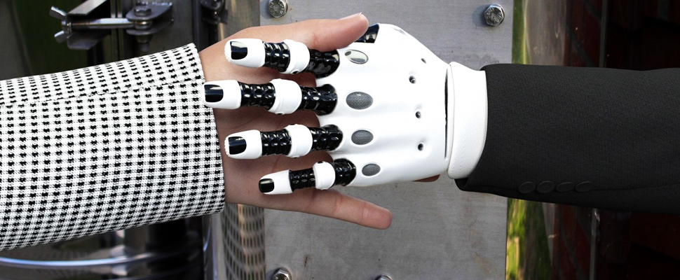 Person touching the hand of a robot