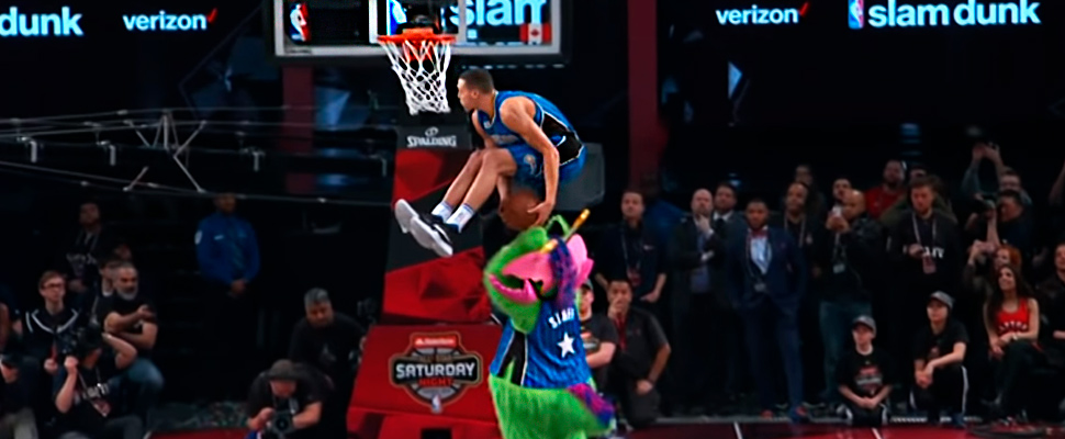 Aaron Gordon jumping on the Orlando Magic mascot.