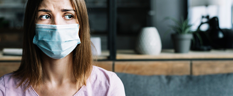 Woman wearing protective mask.