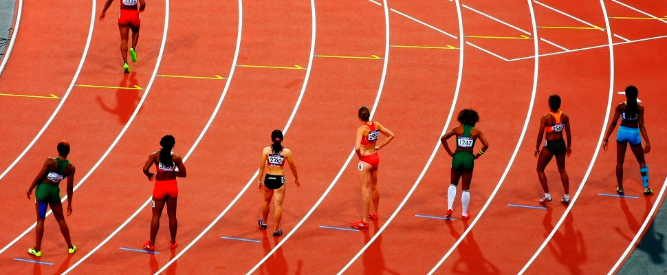 Competitors on a running track.