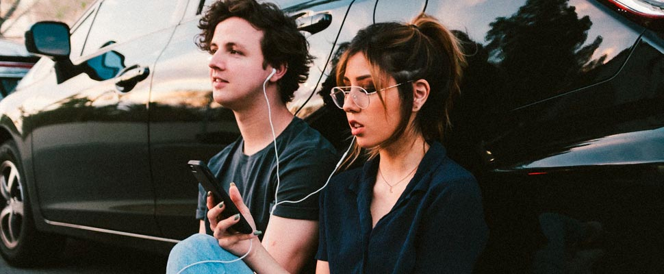 Couple listening to music with headphones.