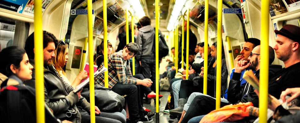 Group of people sitting inside the public transport.