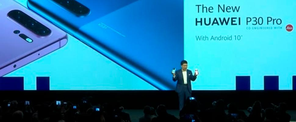 Huawei President presents his P30 pro cell phone.